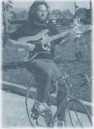 The Bicycling Guitarist rides in a parade in 1994