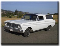 white 1965 Ford Ranchero with white camper shell
