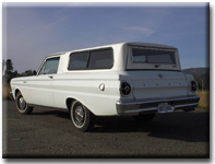 left rear view of white 1965 Ranchero