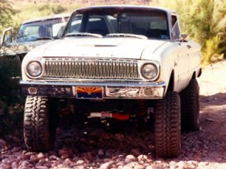 customized 1962 Ranchero four-wheeling on the river