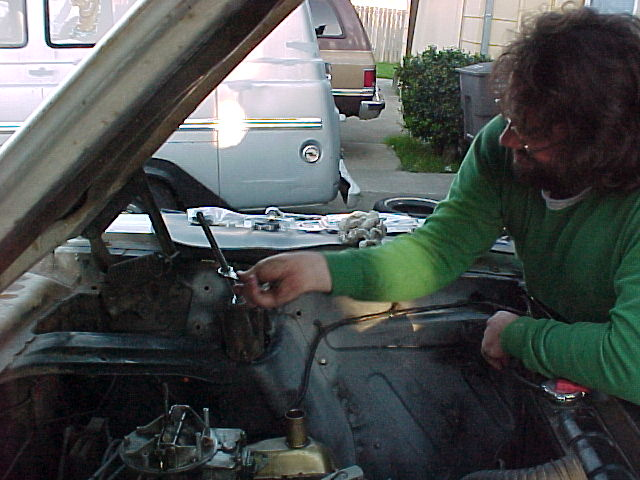 Installing a coil spring in my 1965 Ranchero at Geoff Belleau's house in April 2000