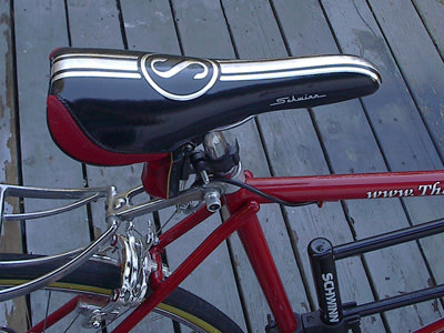 black and red Schwinn seat with chrome stripe and logo