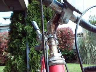 Underside of the handlebar stem with much rust, April 2, 2015.