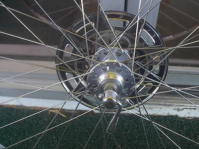 left side of rear wheel